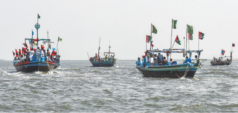 Boats take to the water as part of the rally on Thursday. —Fahim Siddiqi/White Star