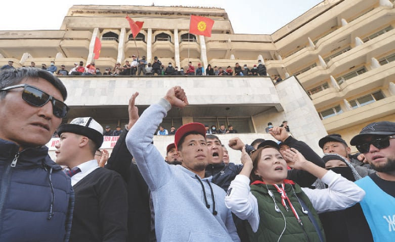 BISHKEK: Supporters of Kyrgyzstan's Prime Minister Sadyr Japarov attend a rally near the official presidential residence on Thursday.—AFP