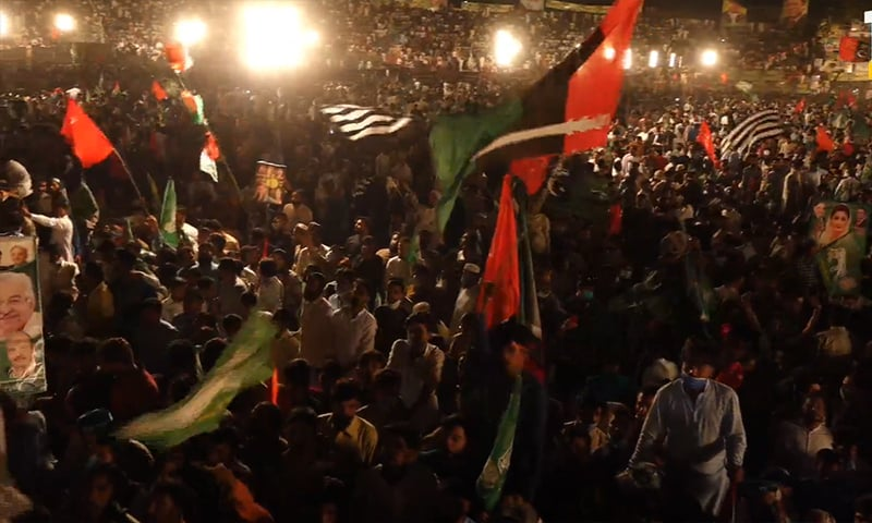Participants of the Gujranwala rally wave flags on Friday. — Screengrab Shehbaz Sharif Facebook