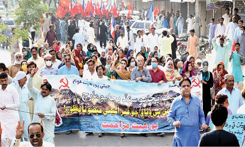THE protesters hold a sit-in outside Hyderabad Press Club on Friday.—Dawn