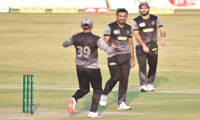 RAWALPINDI: Khyber Pakhtunkhwa fast bowler Wahab Riaz (C) is being congratulated by team-mate Fakhar Zaman as Usman Khan Shinwari looks on during their National T20 Cup match against Northern at the Pindi Cricket Stadium on Friday.—Tanveer Shahzad/White Star