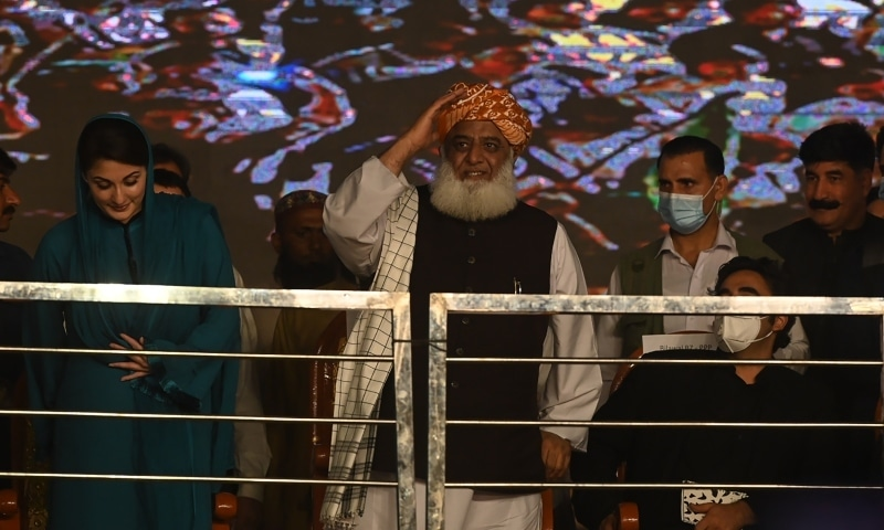 Leader of the newly-formed Pakistan Democratic Movement Maulana Fazlur Rehman (C) salutes to supporters while Maryam Nawaz Sharif (L) stands during the first public rally in the eastern city of Gujranwala on October 16. — AFP