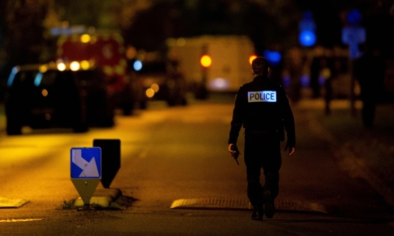 A French police officer stands guard a street in Eragny on October 16 where an attacker was shot dead by policemen after he decapitated a man earlier on the same day in Conflans-Sainte-Honorine. — AFP