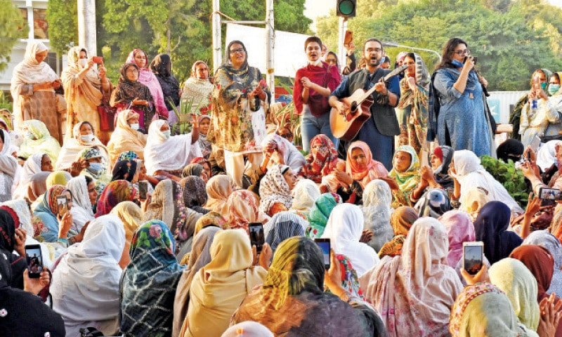 Awami Workers Party activists perform at the site of the protest being staged by lady health workers in Islamabad on Saturday. — Online