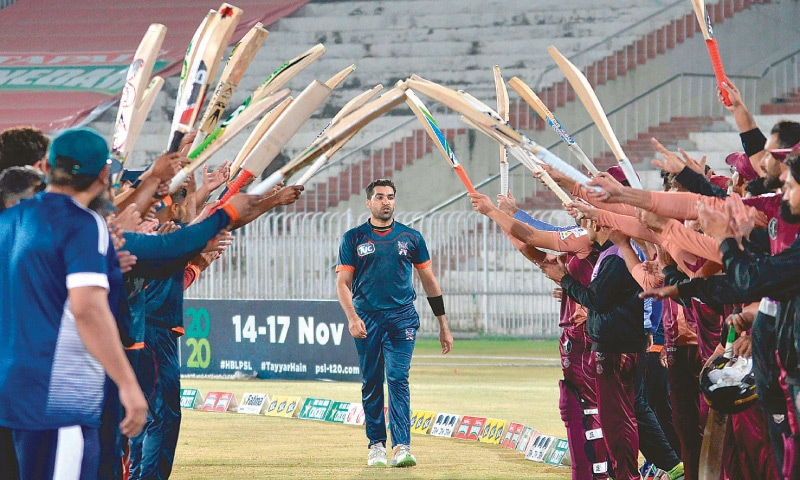 UMAR Gul gets rousing sendoff with a a guard of honour from his Balochistan team-mates and Southern Punjab team at the Pindi Cricket Stadium. — AFP