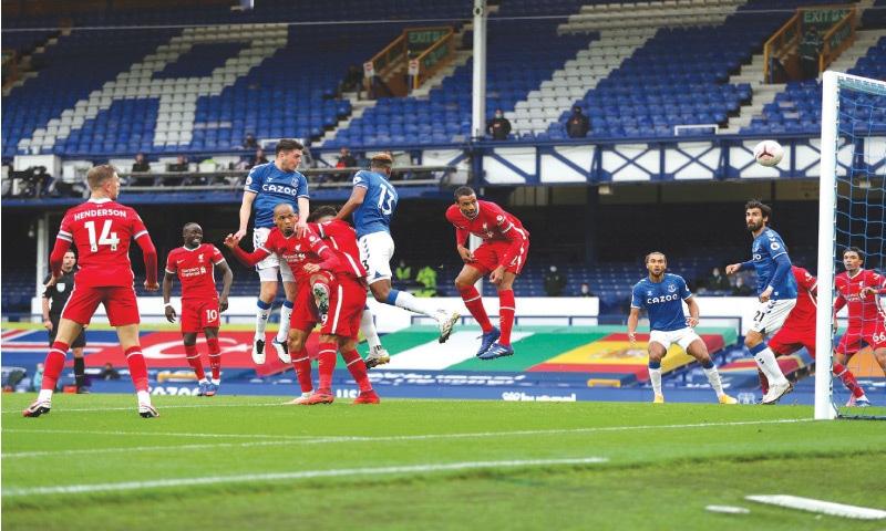 LIVERPOOL: Everton's Michael Keane (third left) scores during the English Premier League match against Liverpool at Goodison Park on Saturday. — AP