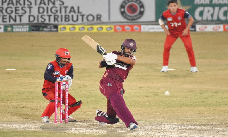 RAWALPINDI: Southern Punjab captain Shan Masood goes on the attack during his unbeaten knock of 79 as Northern wicket-keeper Rohail Nazir looks on in the first semi-final of National T20 Cup at the Pindi Cricket Stadium on Saturday. — Tanveer Shahzad/White Star
