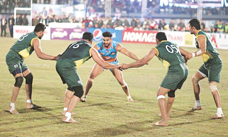 Pakistani kabaddi players surround an Indian player during the 2020 Kabaddi World Cup final in Lahore in February