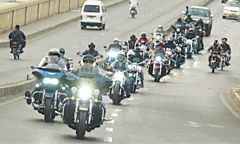 THE impressive HOG, Pakistan procession passes through the Clifton Bridge during one of its rides. — Shahzaib Malik