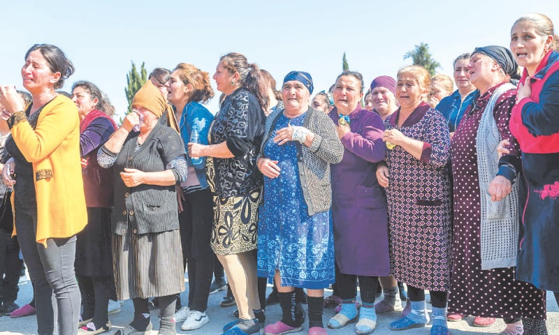 Ganja (Azerbaijan): Relatives of Royal Sahnazarov, his wife Zuleyha Sahnazarova and their daughter Medine Sahnazorava, who were killed when a rocket hit their home, mourn during their funeral on Saturday. — AFP