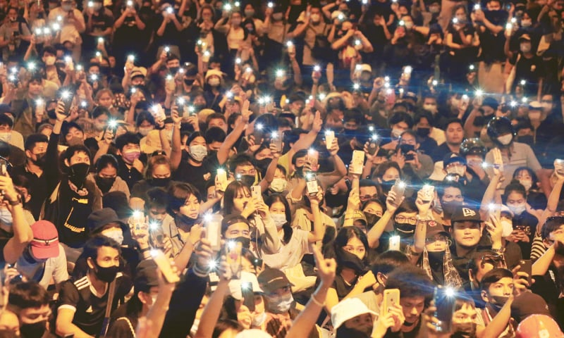 Bangkok: Pro-democracy protesters shine their mobile phone lights during an anti-government protest on Saturday. — Reuters