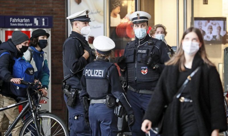 Police with face masks control the coronavirus orders at the train station in Cologne, Germany on Oct 15. — AP/File