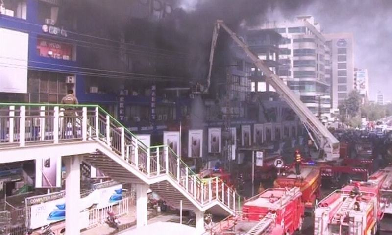 Fire brigades trying ti put out the fire at Hafeez Centre in Lahore. — DawnNewsTV