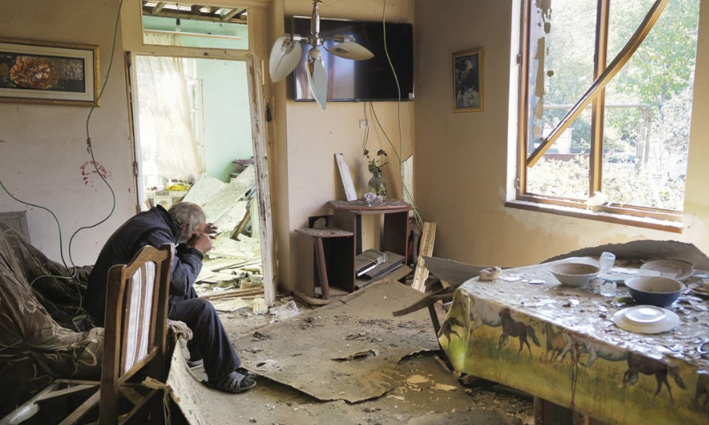 Yury Melkonyan, 64, sits in his house damaged by shelling from Azerbaijan's artillery during a military conflict in Shosh village outside Stepanakert, the disputed region of Nagorno-Karabakh, Saturday, Oct 17. — AP