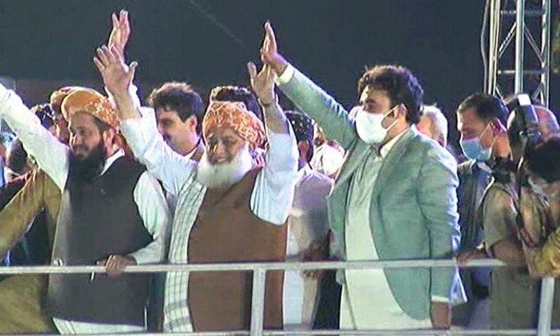 JUI-F chief Maulana Fazlur Rehman and PPP chief Bilawal Bhutto-Zardari wave at the crowd at Bagh-i-Jinnah ahead of PDM's second rally in Karachi. — DawnNewsTV