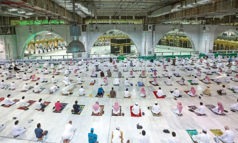 MAKKAH: Worshippers offer Fajr prayers at the Grand Mosque on Sunday for the first time after easing of months-long Covid-19 restrictions. — AFP