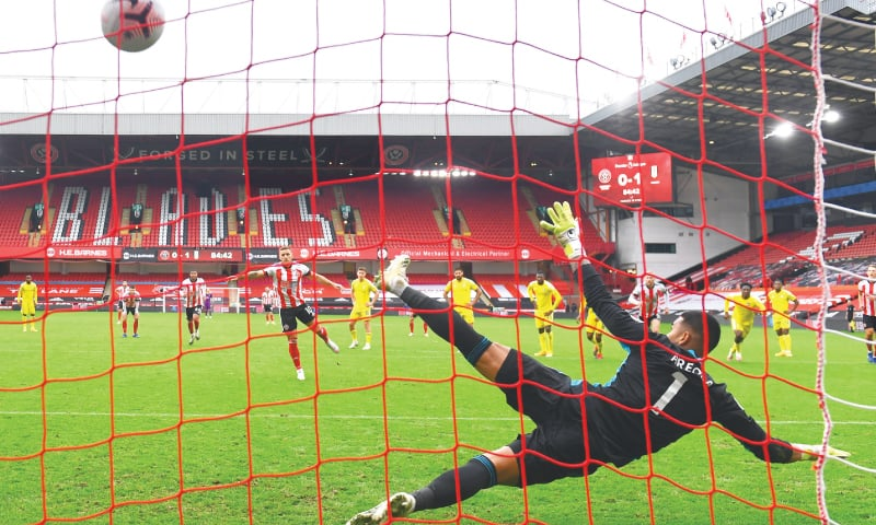 SHEFFIELD: Sheffield United's Billy Sharp scores from a penalty during their Premier League match against Fulham at Bramall Lane on Sunday.—Reuters