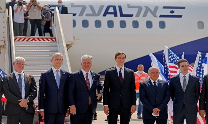 This file photo shows senior US Presidential Adviser Jared Kushner and US National Security Adviser Robert O'Brien posing with members of the Israeli-American delegation in front of the El Al's flight LY971 on August 31. — Reuters