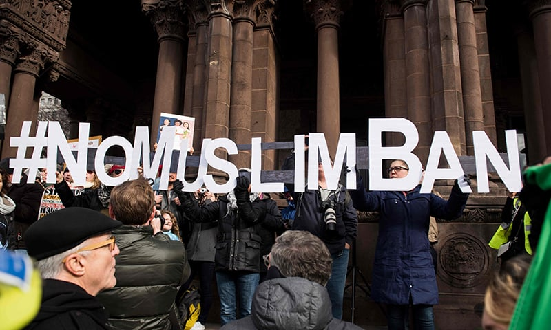 In this photo taken on January 29, 2017 people gather at Copley Square in Boston, Massachusetts to decry US President Donald Trump's sweeping executive order, which restricted refugees and travellers from seven Muslim-majority countries. — AFP/File