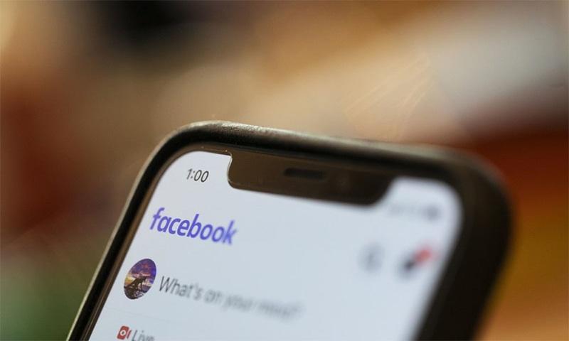 A mobile user checks Facebook on their smartphone. — AP/File