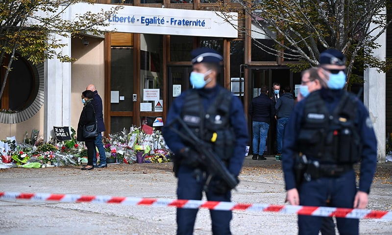 French police target Islamist networks after teacher's beheading