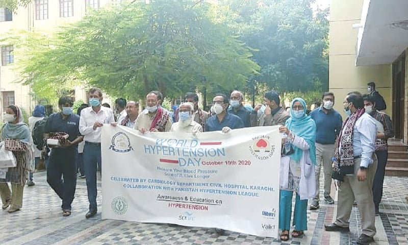 HEALTH experts along with the staff of the Dow Medical College hold a walk to mark World Hypertension Day  on Monday.