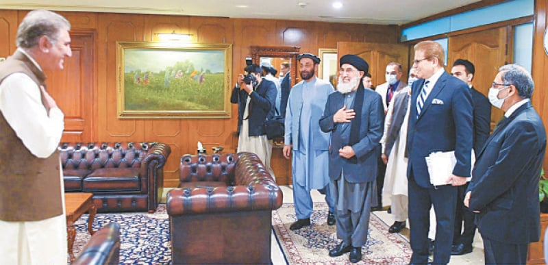 FOREIGN Minister Shah Mehmood Qureshi greets Afghan politician and Hezb-i-Islami leader Gulbuddin Hekmatyar before their meeting at the Foreign Office on Monday.—White Star