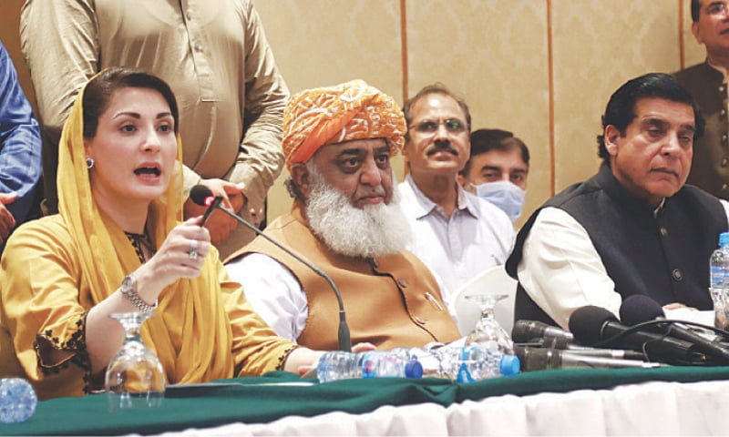 KARACHI: Pakistan Muslim League-Nawaz vice president Maryam Nawaz speaks at a press conference at a local hotel on Monday. Jamiat Ulema-i-Islam chief Maulana Fazlur Rehman and Raja Pervaiz Ashraf of the Pakistan Peoples Party are also seen. — Online