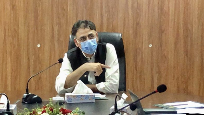 """Planning and Development Minister Asad Umar on Tuesday said people in the country were """"committing a collective blunder by recklessly ignoring"""" all standard operating procedures (SOPs) against coronavirus. — APP/File"""