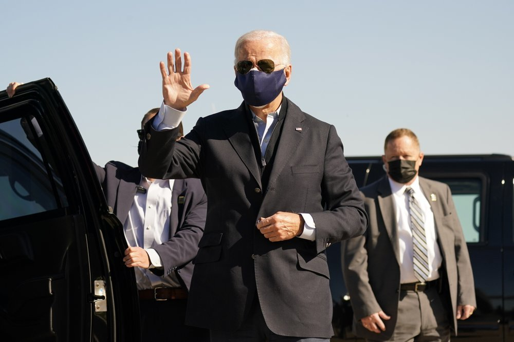 Democratic presidential candidate former Vice President Joe Biden arrives to board his campaign plane at the New Castle Airport on Oct 18. — AP)