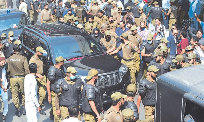 LAHORE: PML-N president Shehbaz Sharif being brought to the court in a vehicle on Tuesday.—White Star