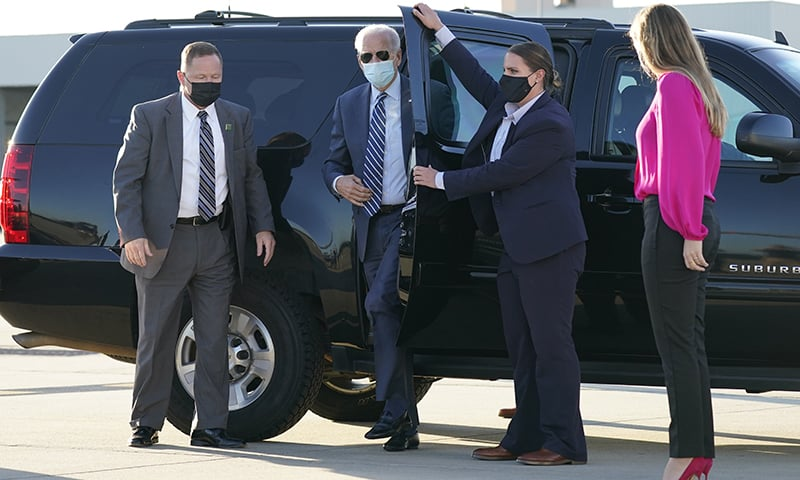 In this Oct 18, 2020, photo, Democratic presidential candidate former vice president Joe Biden steps out to board his campaign plane at Raleigh-Durham International Airport in Morrisville, N.C., en route to Wilmington, Del. — AP