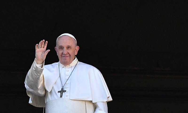 """In this file photo taken on December 25, 2019 Pope Francis waves from the balcony of St Peter's basilica during the traditional """"Urbi et Orbi"""" Christmas message to the city and the world, at St Peter's square in Vatican. — AFP/File"""