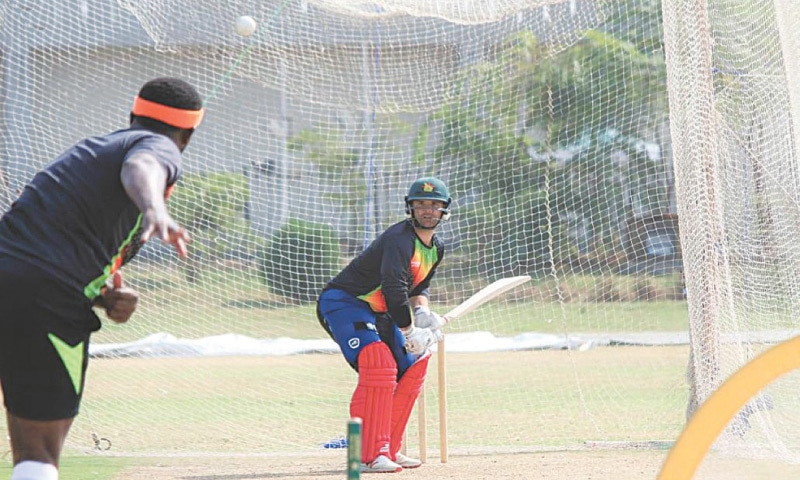 RAWALPINDI: Zimbabwe's Ryan Burl bats during a practice session at the Army Cricket Ground on Wednesday.—INP