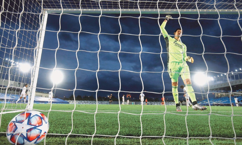 MADRID: Real Madrid goalkeeper Thibaut Courtois reacts after conceding a goal during the Champions League match against Shakhtar Donetsk at the Estadio Alfredo Di Stefano.—Reuters
