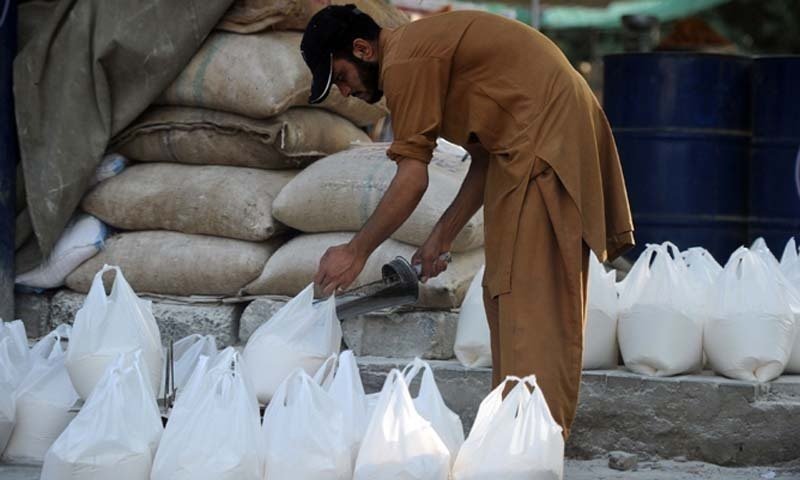 Millers reduced the prices of various varieties of flour by Rs7 per kg prior to release of Sindh government's wheat to millers followed by drop in price of imported and locally-produced wheat. — AFP/File