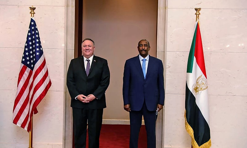 In this August 25 file photo, US Secretary of State Mike Pompeo stands with Sudanese Gen Abdel-Fattah Burhan, the head of the ruling sovereign council, in Khartoum, Sudan. — AP