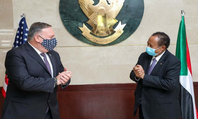 A handout picture provided by Sudan's Prime Minister's office on August 25, 2020, shows US Secretary of State Mike Pompeo (L) greeting Sudanese Prime Minister Abdalla Hamdok (R) in Khartoum. — AFP/ File