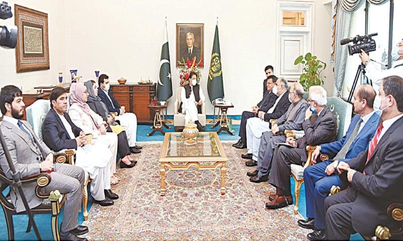 ISLAMABAD: Prime Minister Imran Khan meets a delegation of the Wolesi Jirga of Afghanistan, led by its Speaker Mir Rahman Rahmani, on Friday.—APP