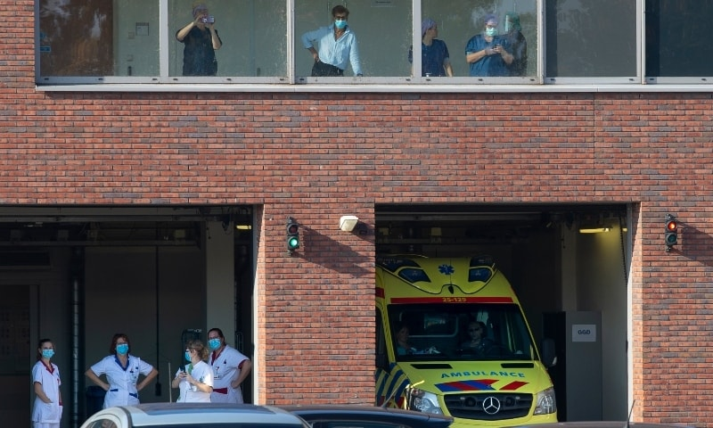 Medical staff waits for a Covid-19 patient to be airlifted by helicopter at Flevoziekenhuis, or FlevoHospital, in Almere, Netherlands on Oct 23. — AP