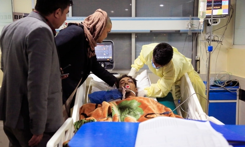 An Afghan receives treatment at hospital after the suicide attack in Kabul, Saturday. — AP
