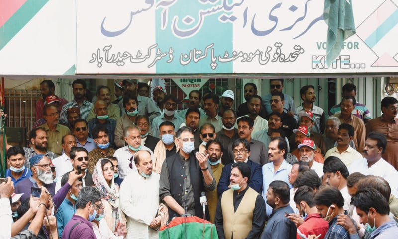 FEDERAL Minister for Planning Asad Umar speaks to the media at the MQM-P office in Hyderabad on Saturday. — Dawn