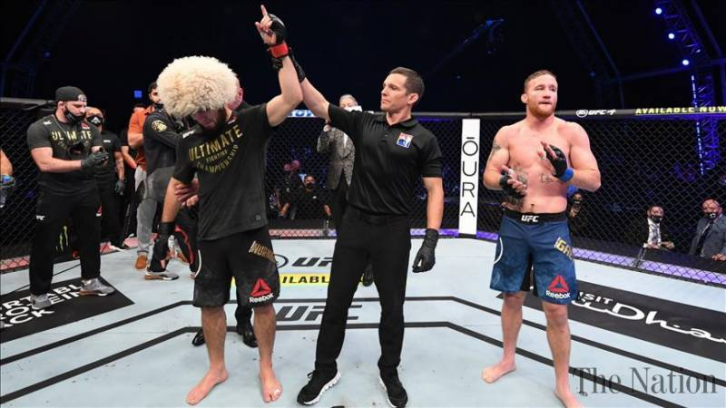 Unbeaten lightweight champion Khabib Nurmagomedov retired from mixed martial arts after stopping Justin Gaethje with a triangle choke early in the second round at UFC 254 on Saturday night. — Anadolu Agency