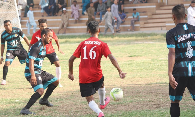 KARACHI United's Anees passes the ball during the Pakistan Football Federation League match against Gwadar Port Authority at the Drigh Road Union Ground on Sunday.—Courtesy PFF