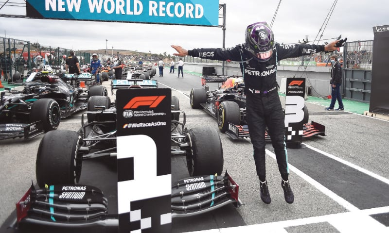 Mercedes' Lewis Hamilton celebrates after winning the Portuguese F1 Grand Prix at the Algarve International Circuit on Sunday.—Reuters