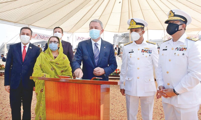 Turkish Defence Minister Hulusi Akar performs the keel-laying of Milgem Class Corvettes being built at Karachi Shipyard and Engineering Works for Pakistan Navy on Sunday.—APP