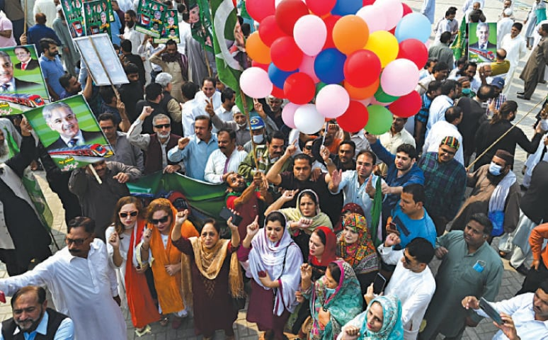 PML-N activists gather at Jain Mandir Chowk to celebrate the launch of Orange Line Train project. — White Star