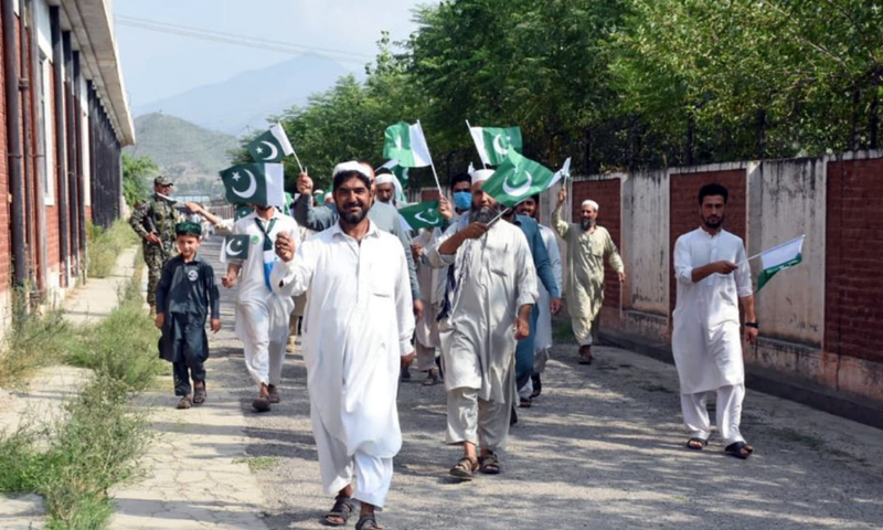 In this July 2019 file photo, people proudly wave the flag as they come out to vote for the first provincial polls in tribal areas. — File photo