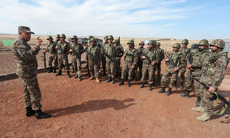 Armenian reservists listen to instructions while undergoing training at a firing range before their departure for the front line in the course of a military conflict with the armed forces of Azerbaijan over the breakaway region of Nagorno-Karabakh on October 25. — Reuters