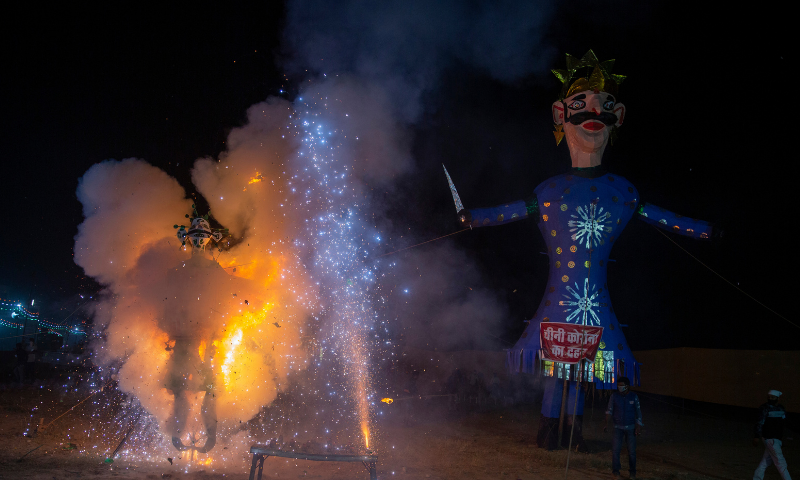An effigy depicting coronavirus, a new addition this year, goes up in flames during Dussehra festival celebrations toned down due to the coronavirus pandemic in New Delhi, India on Sunday. — AP